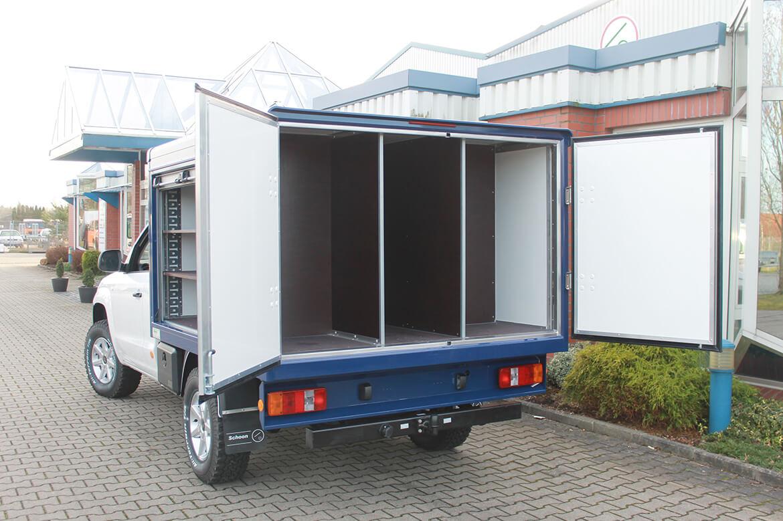 Schoon Kofferaufbau mit Flügeltüren und seitlichen Aluminium Feuerwehrrollos für Pickups