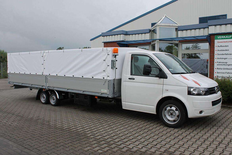 Volkswagen Transporter Zugkopf mit AL KO Chassis und Schoon Pritsche extra lang mit Plane Spriegel
